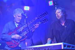 Jack Foster and David Medd are pictured here.  Jack is play a Gibson double-neck guitar and Dave is playing keyboard.